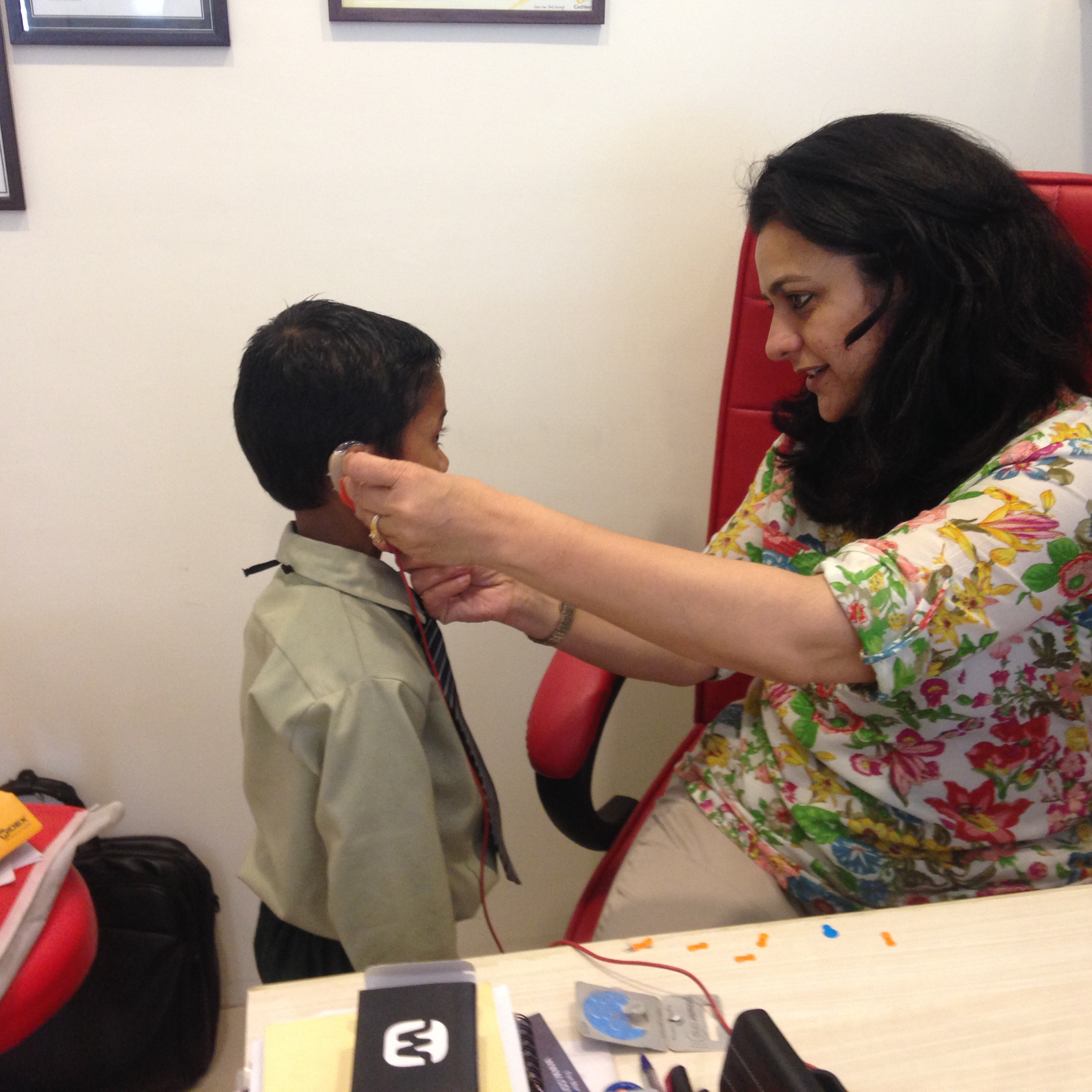 Hearing Aid being fitted to a hearing impaired child